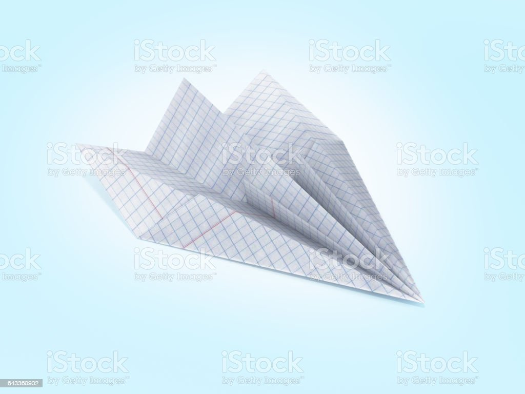 paper plane made with graph paper on blue gradient background stock photo