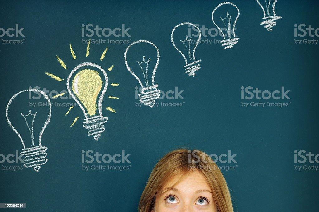 Pensive Woman Looking at Light bulbs vector art illustration