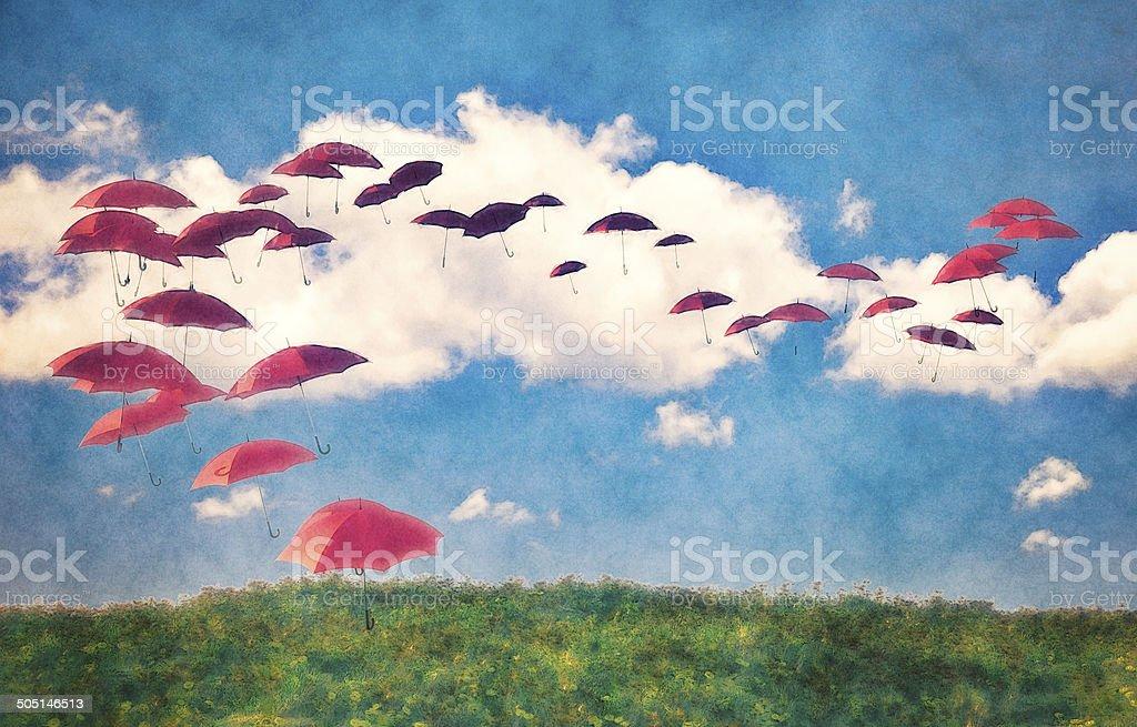 Red umbrellas in the sky vector art illustration