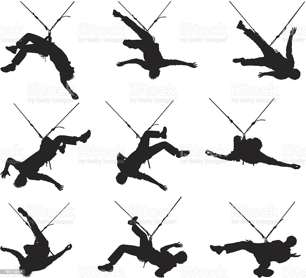Rock climbing men hanging from safety ropes royalty-free stock vector art