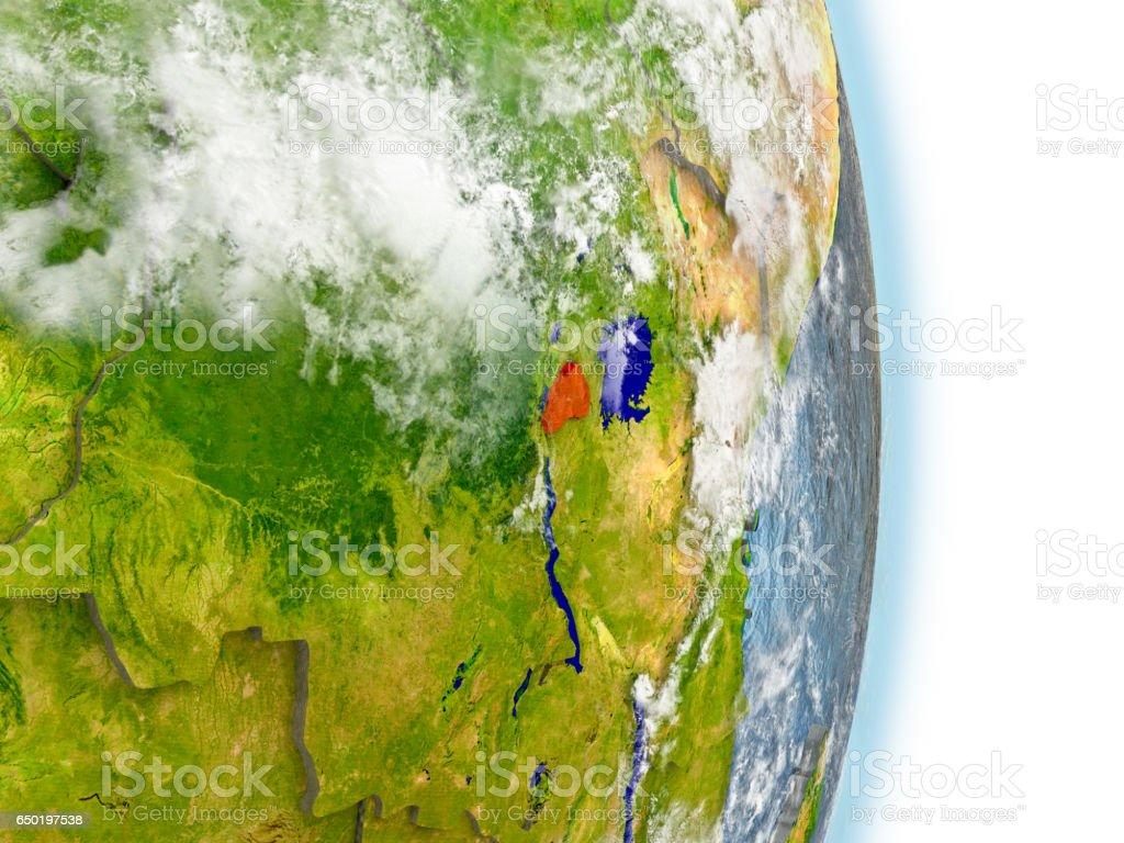 Rwanda in red on Earth stock photo