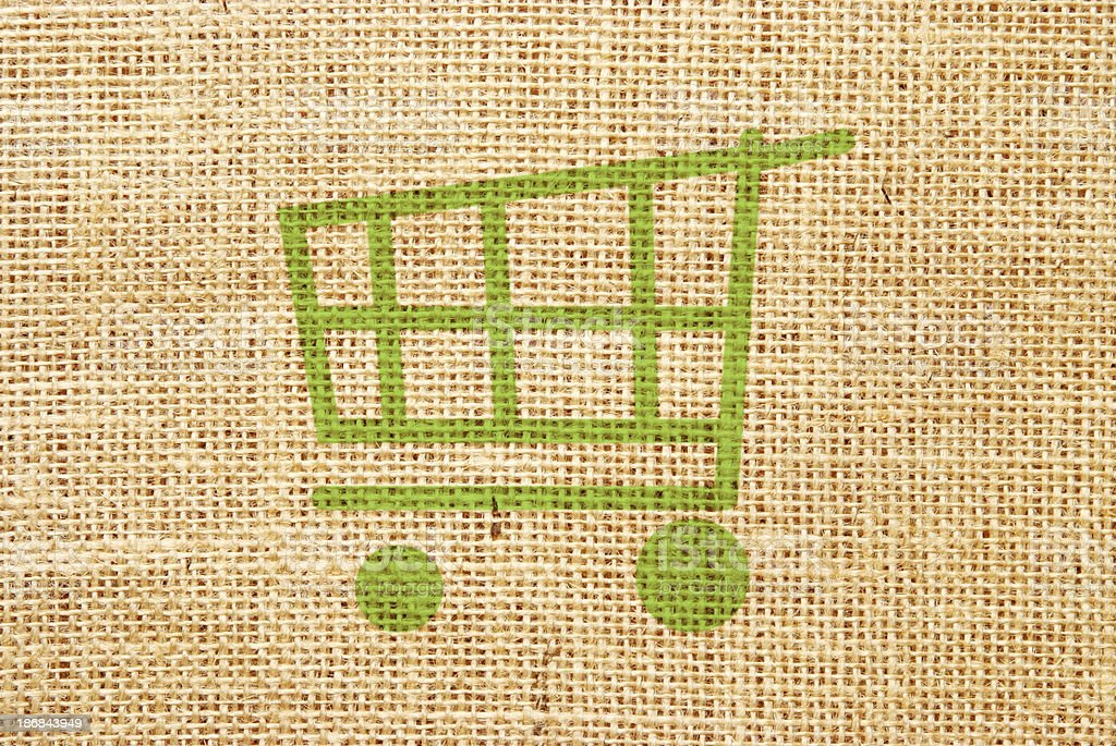 Shopping cart on hessian material royalty-free stock vector art