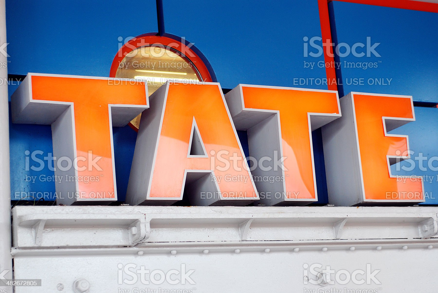 Sign of the Tate gallery in Liverpool Albert Dock royalty-free stock vector art