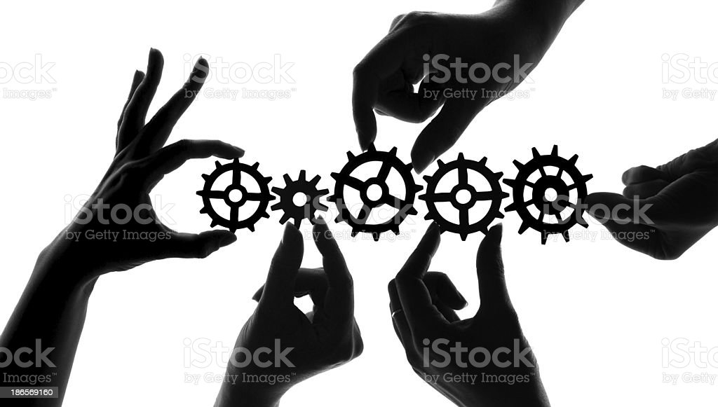 Silhouetted hands holding mechanical cogs and gears, teamwork and collaboration concept vector art illustration