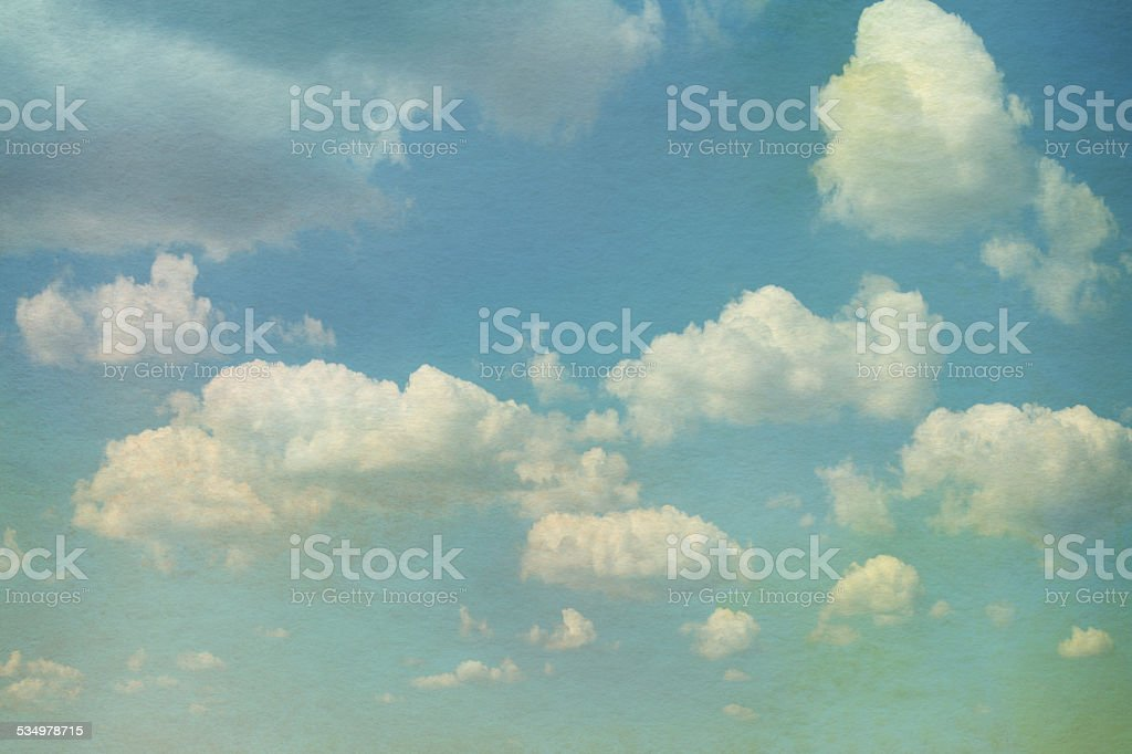 Sky with clouds in grunge textured style. vector art illustration