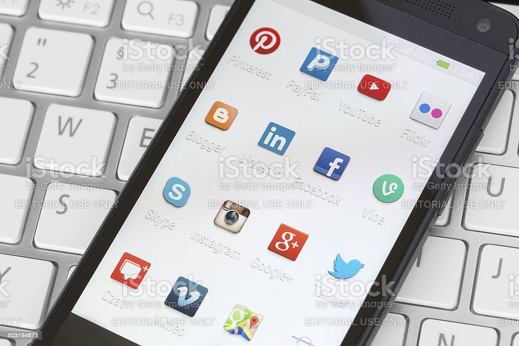 Social media icons on smart phone screen vector art illustration
