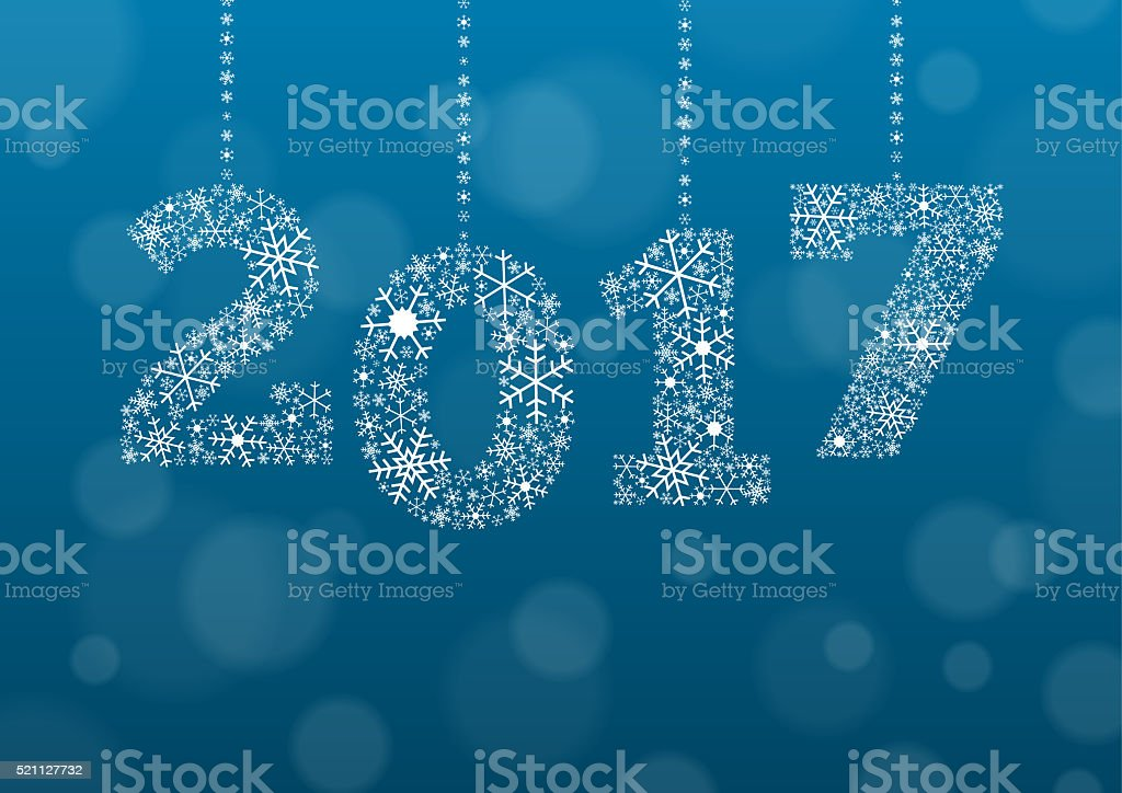 2017 text made of snowflakes on bokeh background stock photo