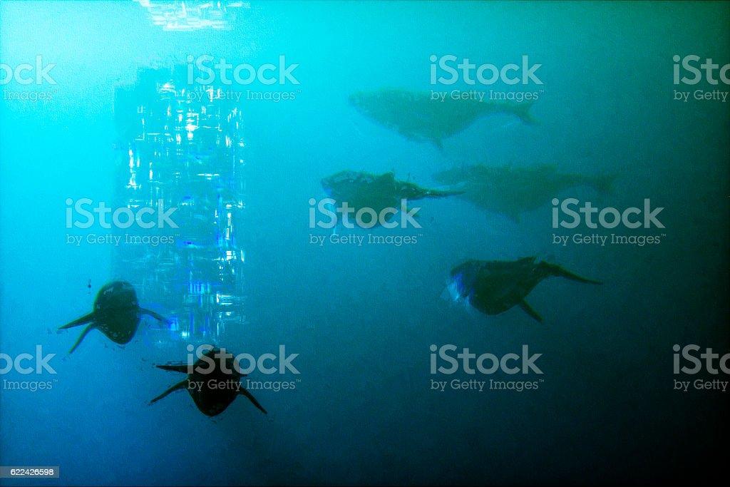 Underwater fantasy whales swimming towards glowing alien artifact vector art illustration
