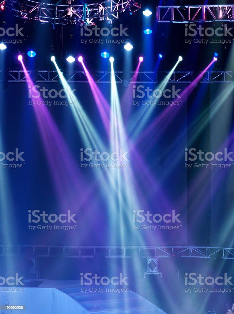 Vector Stage Spotlight with Laser rays vector art illustration