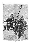 Victorian illustration fishermen dragging fishing boat up the shingle beach