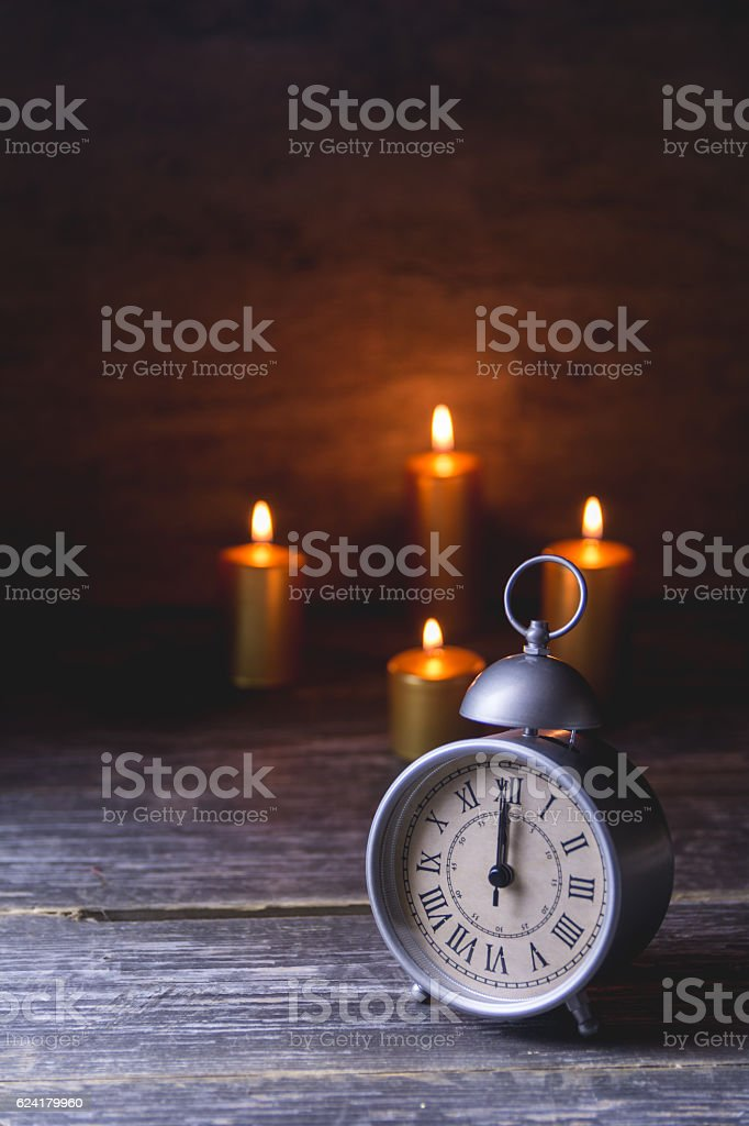 Vintage Clock with Candles in the Background vector art illustration
