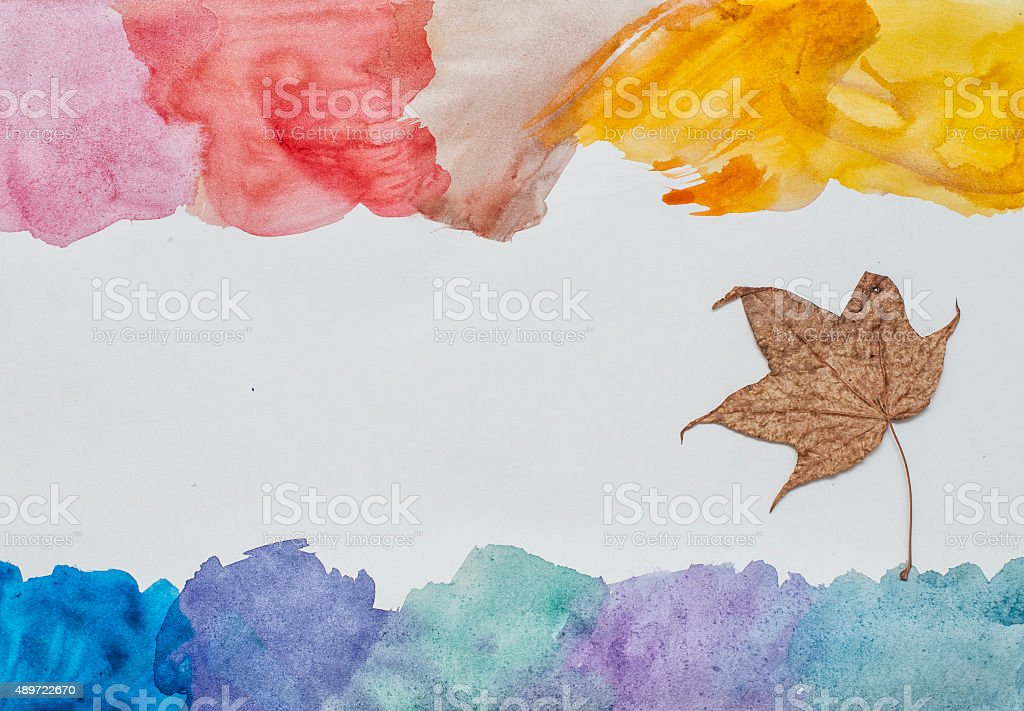 Watercolor strokes and dry maple leaf vector art illustration