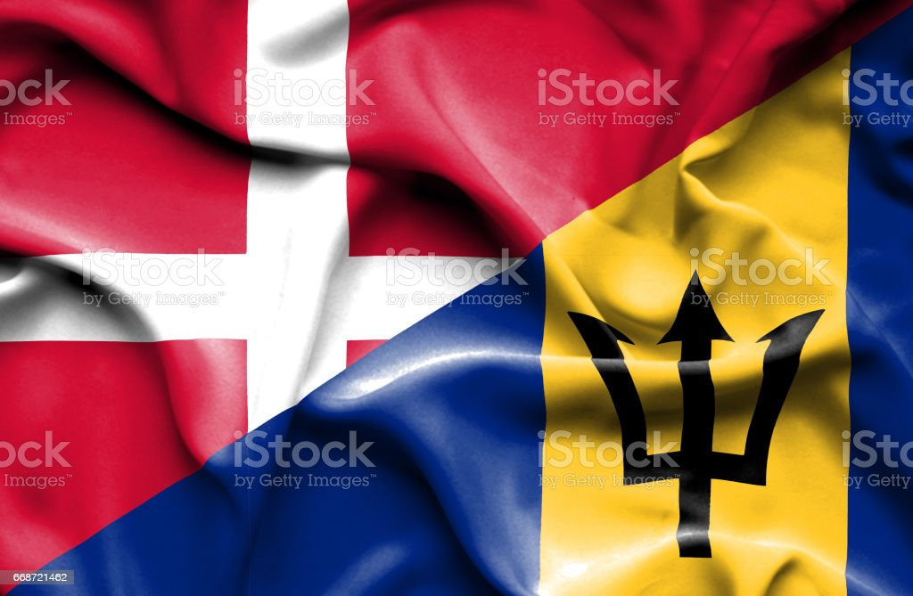 Waving flag of Barbados and Denmark stock photo