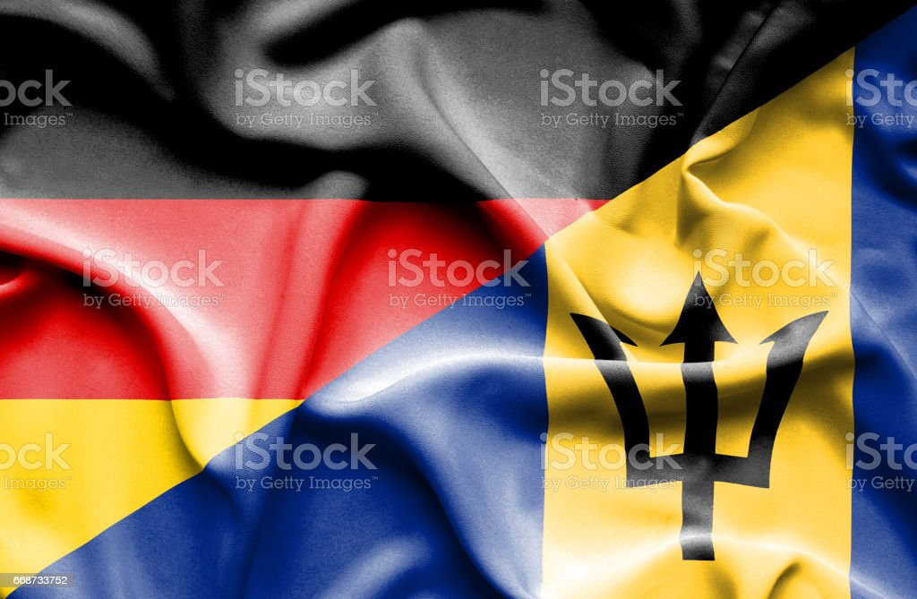 Waving flag of Barbados and Germany stock photo