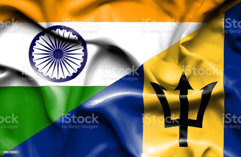 Waving flag of Barbados and India stock photo