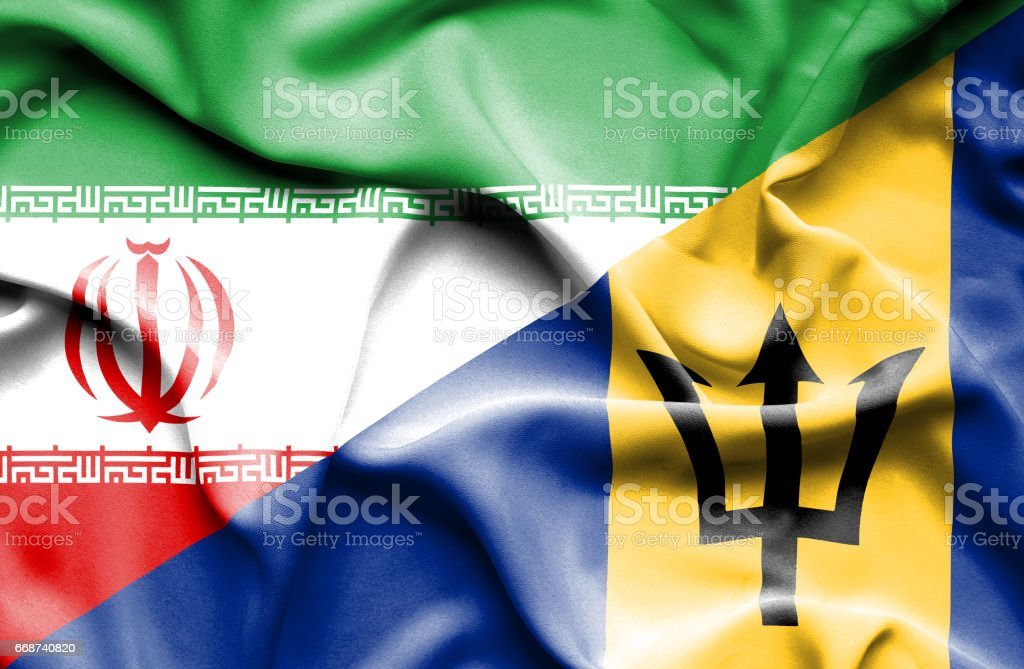Waving flag of Barbados and Iran stock photo