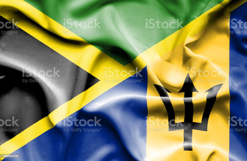 Waving flag of Barbados and Jamaica stock photo