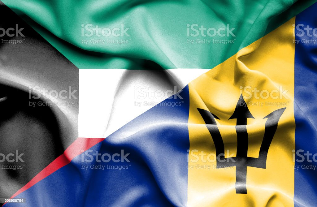 Waving flag of Barbados and Kuwait stock photo