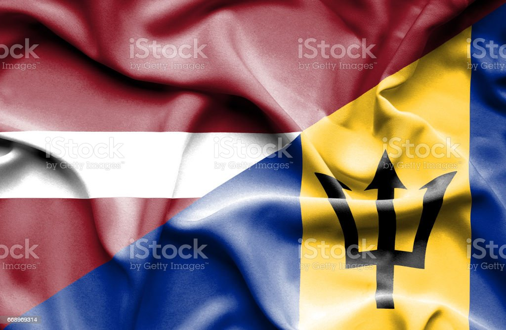Waving flag of Barbados and Latvia stock photo
