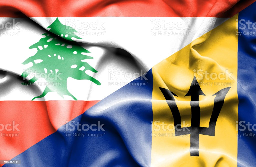 Waving flag of Barbados and Lebanon stock photo