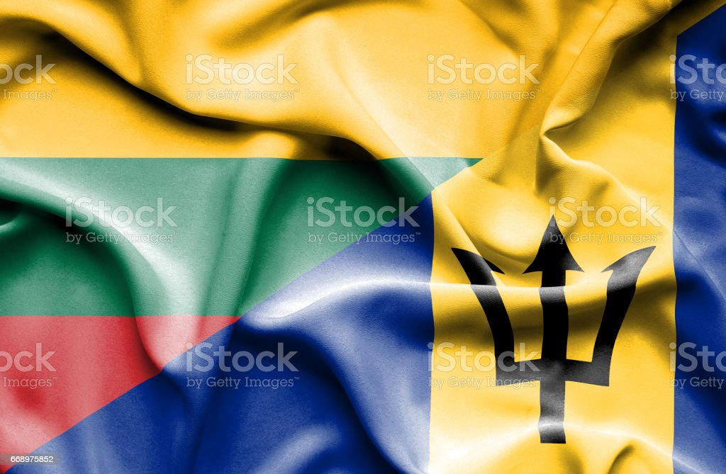 Waving flag of Barbados and Lithuania stock photo