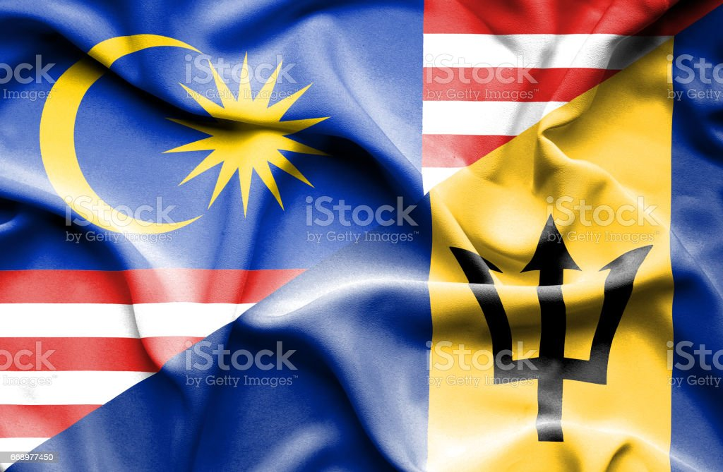 Waving flag of Barbados and Malaysia stock photo
