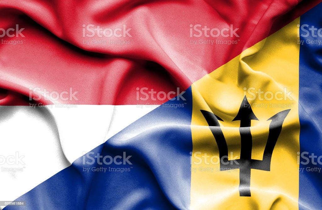 Waving flag of Barbados and Monaco stock photo