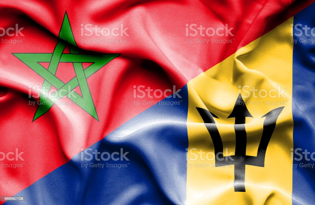 Waving flag of Barbados and Morocco stock photo