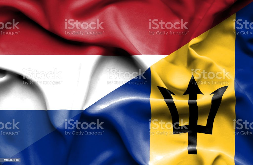 Waving flag of Barbados and Netherlands stock photo