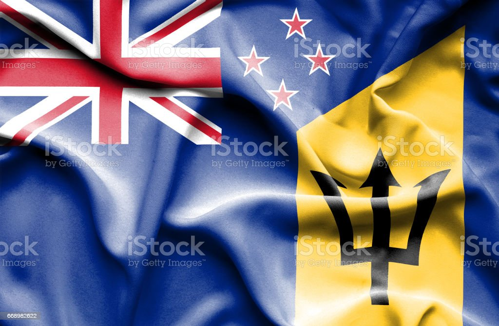 Waving flag of Barbados and New Zealand stock photo