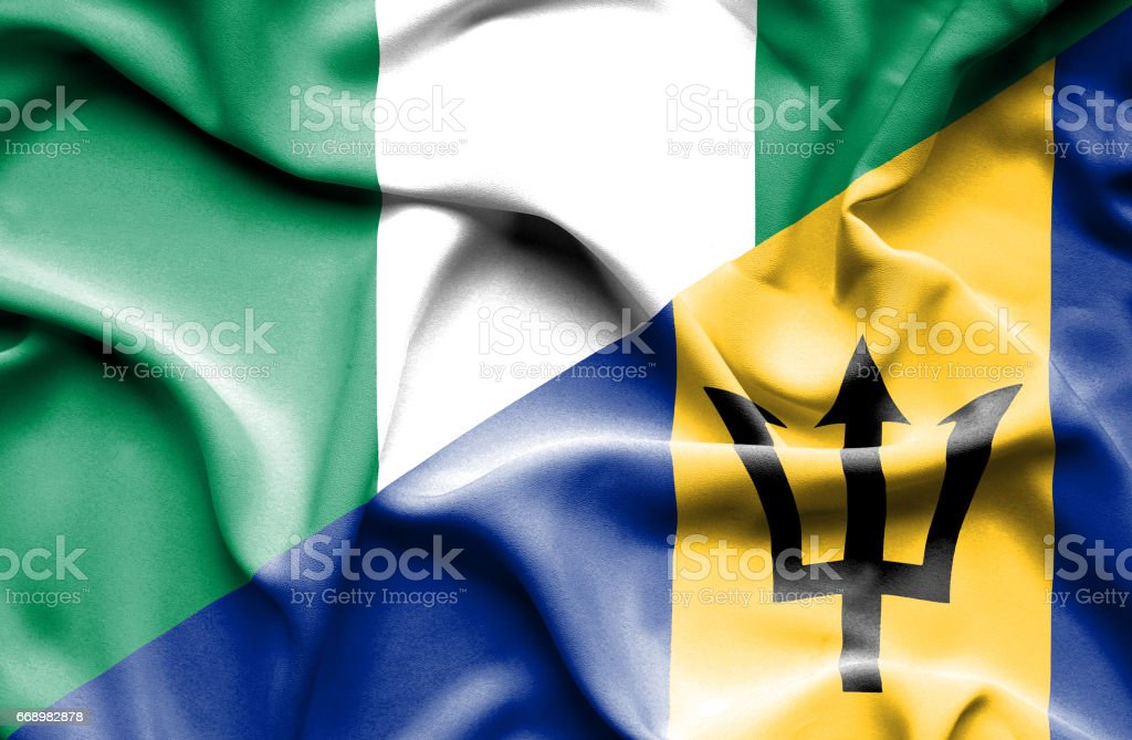 Waving flag of Barbados and Nigeria stock photo