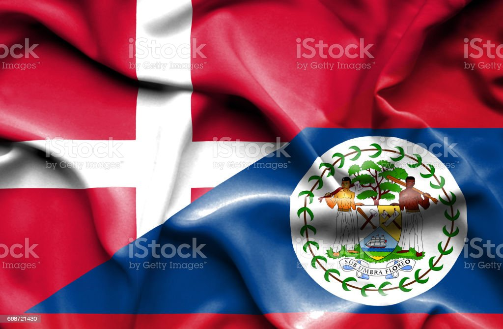 Waving flag of Belize and Denmark stock photo