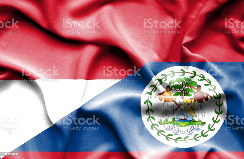 Waving flag of Belize and Monaco stock photo