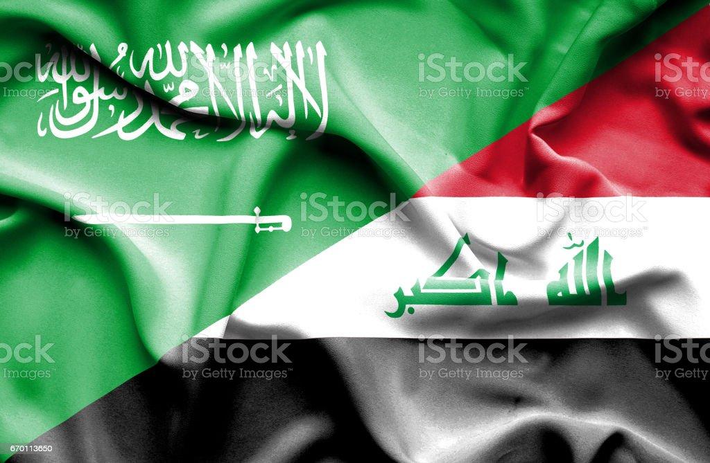 Waving flag of Iraq and Saudi Arabia stock photo