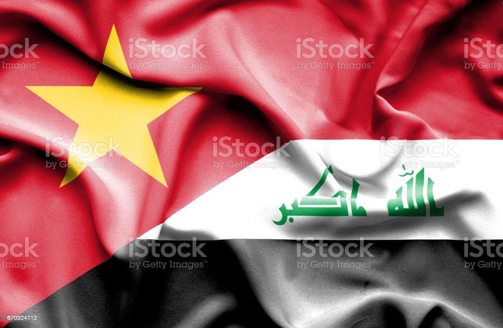 Waving flag of Iraq and Vietnam stock photo