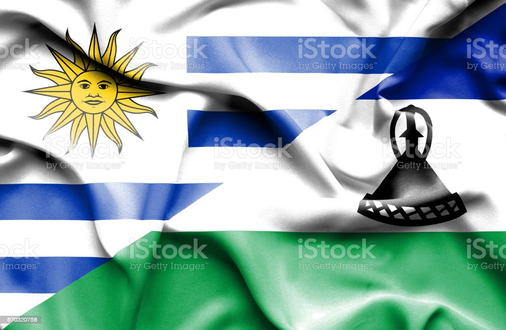 Waving flag of Lesotho and Uruguay vector art illustration