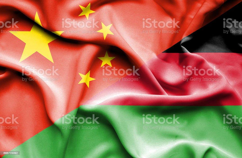 Waving flag of Malawi and China vector art illustration