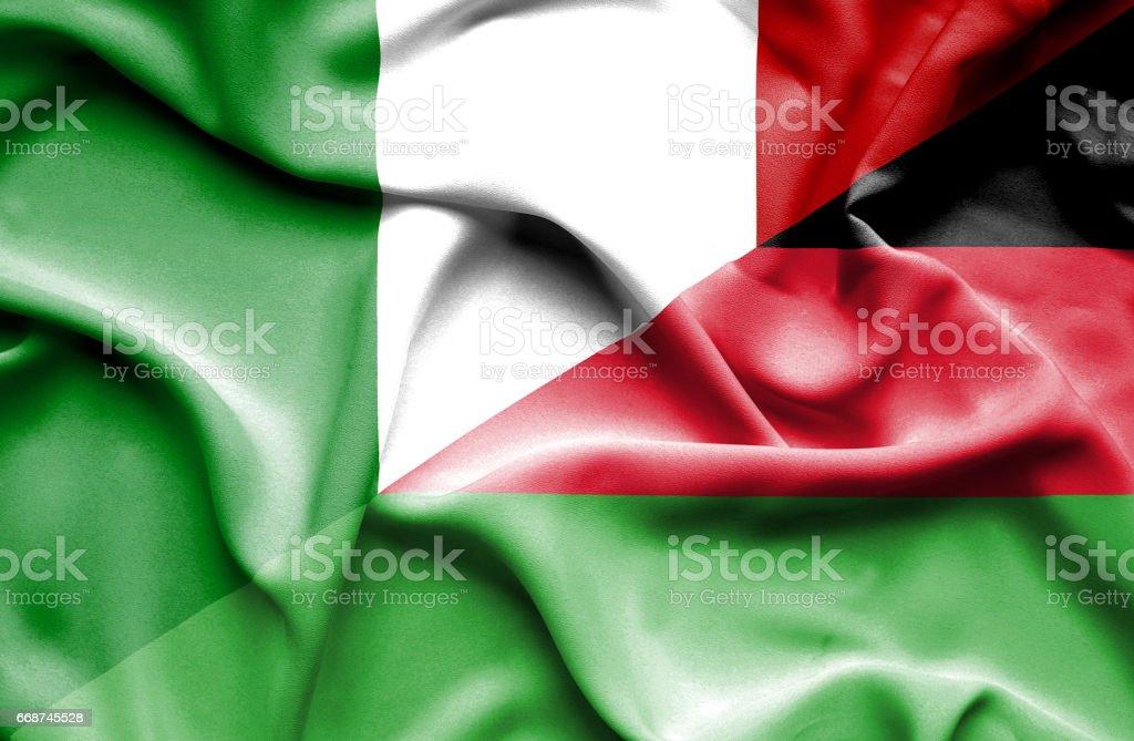 Waving flag of Malawi and Italy vector art illustration
