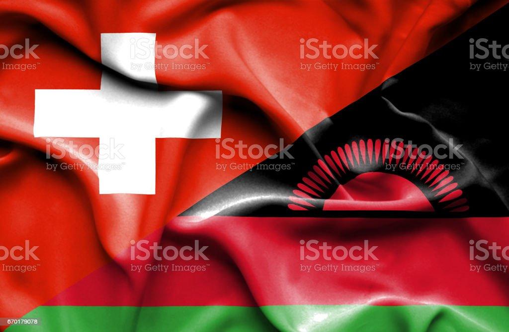 Waving flag of Malawi and Switzerland vector art illustration