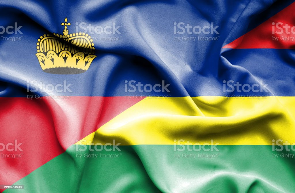 Waving flag of Mauritius and Lichtenstein stock photo