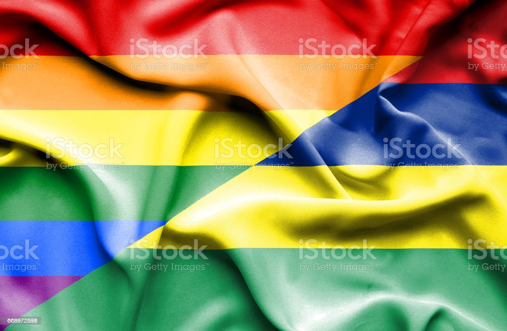 Waving flag of Mauritius and Pride stock photo