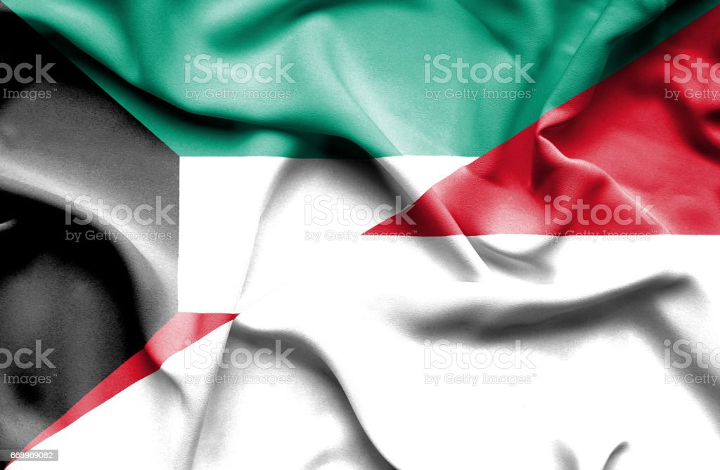 Waving flag of Monaco and Kuwait stock photo
