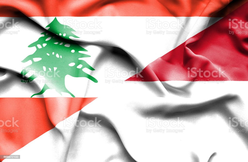 Waving flag of Monaco and  Lebanon stock photo