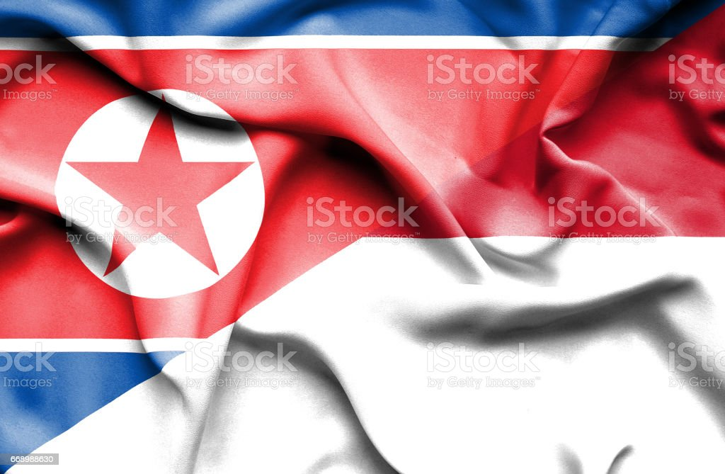 Waving flag of Monaco and North Korea stock photo
