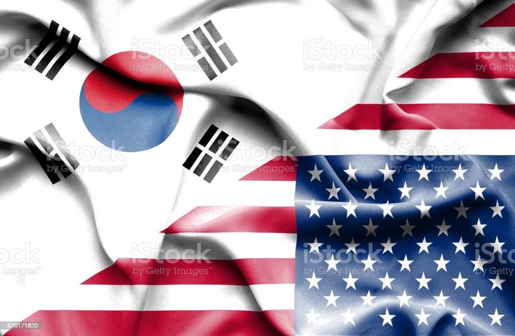 Waving flag of United States of America and South Korea stock photo