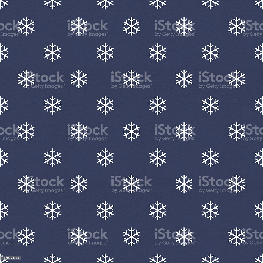 White snowflakes on navy blue vintage wrapping paper vector art illustration