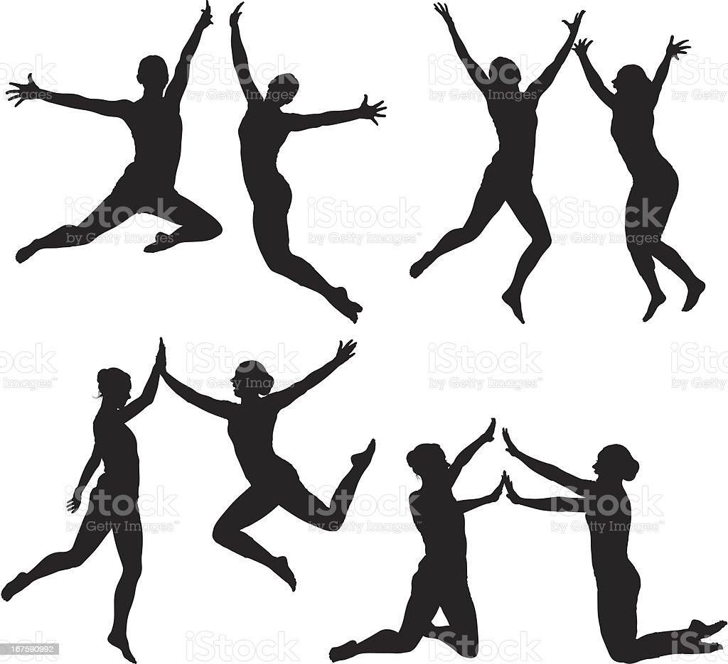 Women jumping royalty-free stock vector art