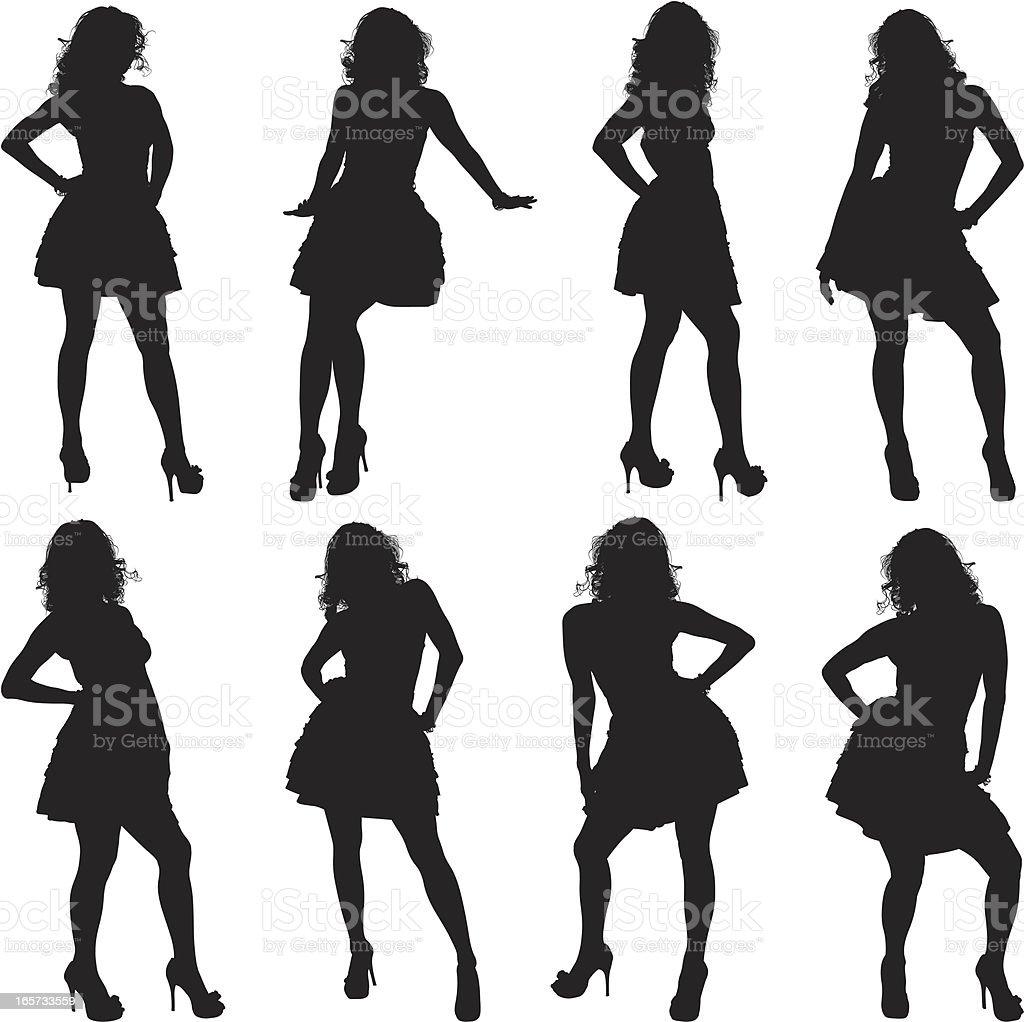 Women posing in designer dresses royalty-free stock vector art