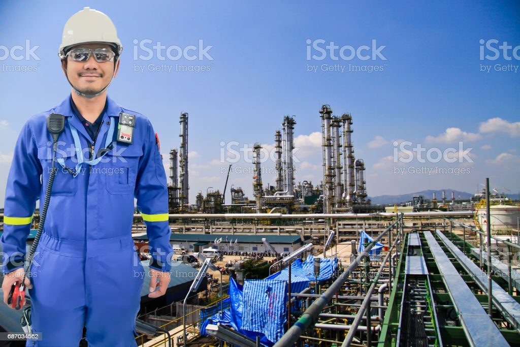 Working engineer at petrochemical oil and gas refinery vector art illustration