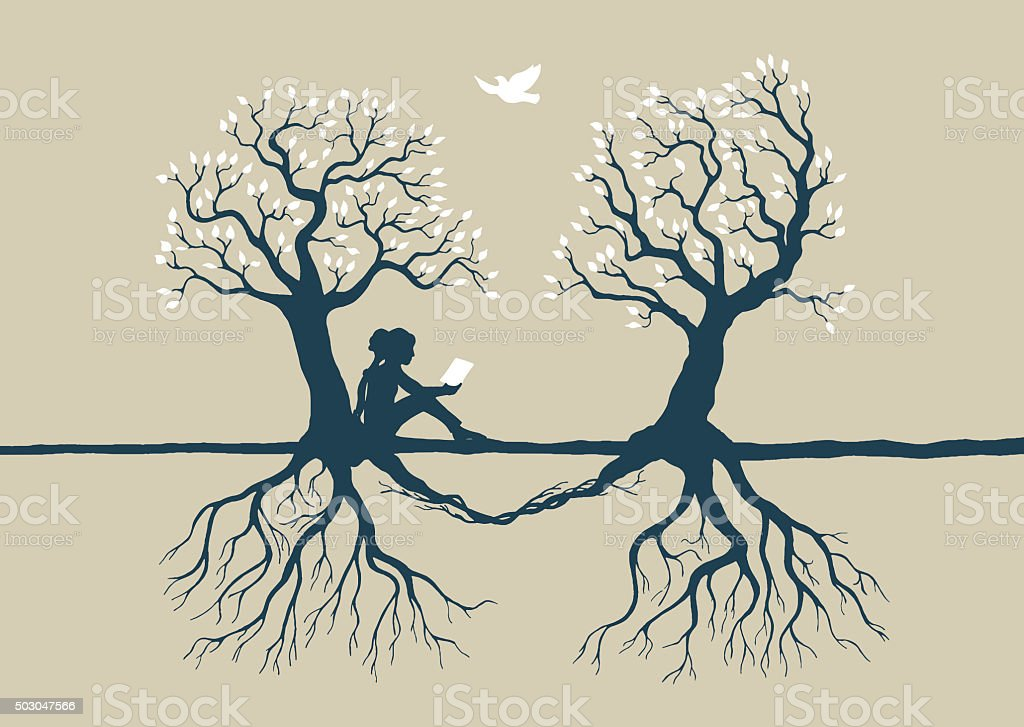 young reading girl under two loving trees stock photo